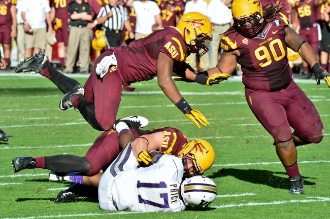 Oct 19, 2013; Tempe, AZ, USA; Arizona State Sun Devils defensive end Gannon Conway (95) sacks Washington Huskies quarterback Keith Price (17) during the first half at Sun Devil Stadium. Mandatory Credit: Matt Kartozian-USA TODAY Sports