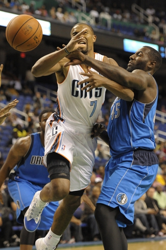 Oct 19, 2013; Greensboro, NC, USA; Charlotte Bobcats guard Ramon Sessions (7) shoots the ball as Dallas Mavericks center forward DeJuan Blair (45) defends during the game at Greensboro Coliseum. The Mavericks won 89-83. Mandatory Credit: Sam Sharpe-USA TODAY Sports
