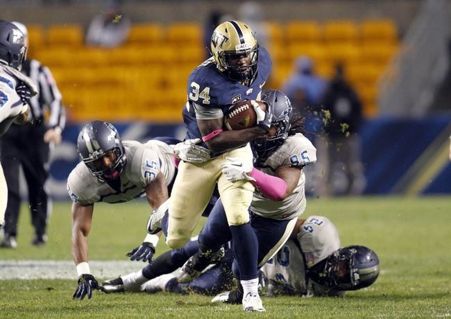 Oct 19, 2013; Pittsburgh, PA, USA; Pittsburgh Panthers running back Isaac Bennett (34) rushes the ball against the Old Dominion Monarchs during the third quarter at Heinz Field.  Pittsburgh won 35-24. Mandatory Credit: Charles LeClaire-USA TODAY Sports