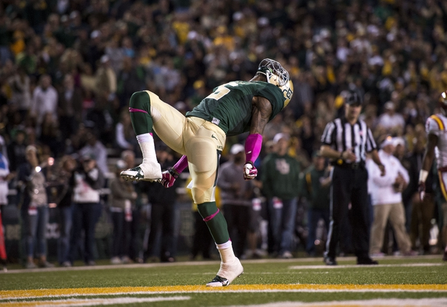 Oct 19, 2013; Waco, TX, USA; Baylor Bears safety Ahmad Dixon (6) celebrates the defensive stop of the Iowa State Cyclones offense during the second half at Floyd Casey Stadium. The Bears defeated the Cyclones 71-7. Mandatory Credit: Jerome Miron-USA TODAY Sports
