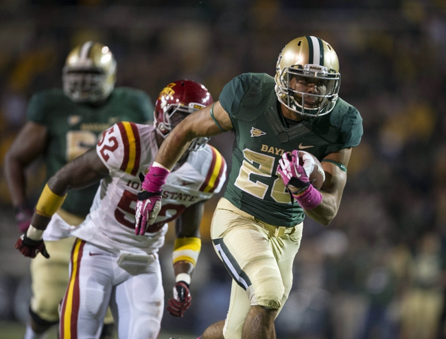 Oct 19, 2013; Waco, TX, USA; Baylor Bears running back Devin Chafin (28) scores a touchdown against the Iowa State Cyclones during the second half at Floyd Casey Stadium. The Bears defeated the Cyclones 71-7. Mandatory Credit: Jerome Miron-USA TODAY Sports
