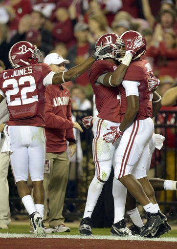 Oct 19, 2013; Tuscaloosa, AL, USA;  Alabama Crimson Tide wide receiver Amari Cooper (9) celebrates his  touchdown with running back Kenyan Drake (17) and wide receiver Christion Jones (22) against the Arkansas Razorbacks during the second quarter at Bryant-Denny Stadium. Mandatory Credit: John David Mercer-USA TODAY Sports