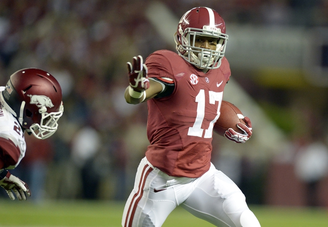 Oct 19, 2013; Tuscaloosa, AL, USA; Alabama Crimson Tide running back Kenyan Drake (17) rushes the ball up the field against the Arkansas Razorbacks during the first quarter at Bryant-Denny Stadium. Mandatory Credit: John David Mercer-USA TODAY Sports