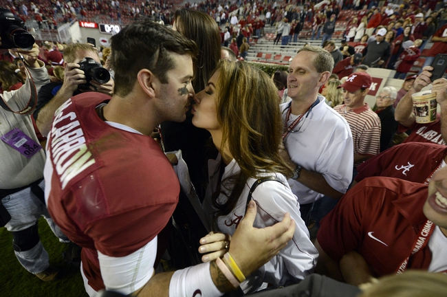 Oct 19, 2013; Tuscaloosa, AL, USA; Alabama Crimson Tide quarterback A.J. McCarron (10) kisses his girlfriend Katherine Webb following their 52-0 victory over the Arkansas Razorbacks at Bryant-Denny Stadium. Mandatory Credit: John David Mercer-USA TODAY Sports