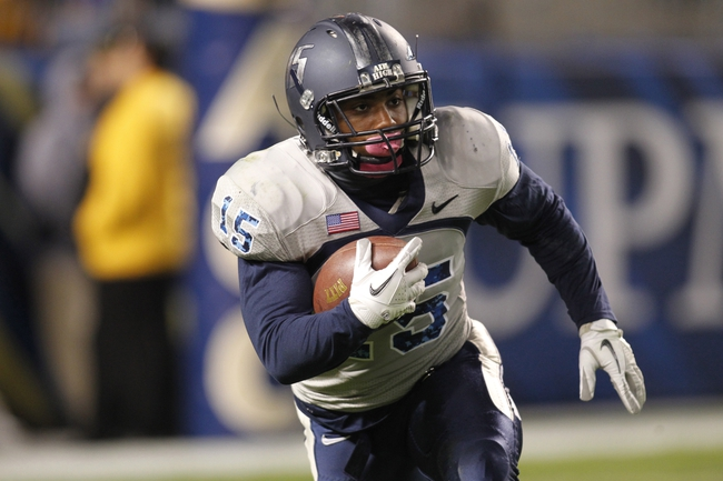 Oct 19, 2013; Pittsburgh, PA, USA; Old Dominion Monarchs cornerback Aaron Evans (15) returns a kick-off against the Pittsburgh Panthers during the third quarter at Heinz Field.  Pittsburgh won 35-24. Mandatory Credit: Charles LeClaire-USA TODAY Sports