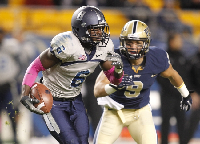 Oct 19, 2013; Pittsburgh, PA, USA; Old Dominion Monarchs wide receiver Zach Pascal (6) runs after a pass reception against Pittsburgh Panthers defensive back Ray Vinopal (9) during the third quarter at Heinz Field.  Pittsburgh won 35-24. Mandatory Credit: Charles LeClaire-USA TODAY Sports