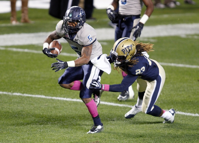 Oct 19, 2013; Pittsburgh, PA, USA; Old Dominion Monarchs wide receiver Antonio Vaughan (5) scores on a 17 yard touchdown run past Pittsburgh Panthers defensive back Lafayette Pitts (23) during the third quarter at Heinz Field.  Pittsburgh won 35-24. Mandatory Credit: Charles LeClaire-USA TODAY Sports