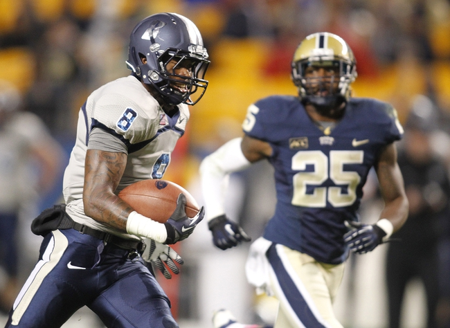 Oct 19, 2013; Pittsburgh, PA, USA; Old Dominion Monarchs wide receiver Blair Roberts (8) scores on a forty-seven yard touchdown catch against the Pittsburgh Panthers during the third quarter at Heinz Field.  Pittsburgh won 35-24. Mandatory Credit: Charles LeClaire-USA TODAY Sports