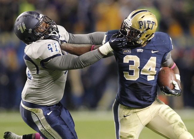 Oct 19, 2013; Pittsburgh, PA, USA; Old Dominion Monarchs linebacker Richie Staton (41) and Pittsburgh Panthers running back Isaac Bennett (34) grab each others face masks during the fourth quarter at Heinz Field.  Pittsburgh won 35-24. Mandatory Credit: Charles LeClaire-USA TODAY Sports