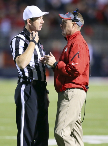 Oct 19, 2013; Oxford, MS, USA; Mississippi Rebels head coach Hugh Freeze talks to an official during the game against the LSU Tigers at Vaught-Hemingway Stadium. Mississippi Rebels defeat the LSU Tigers 27-24.  Mandatory Credit: Spruce Derden-USA TODAY Sports