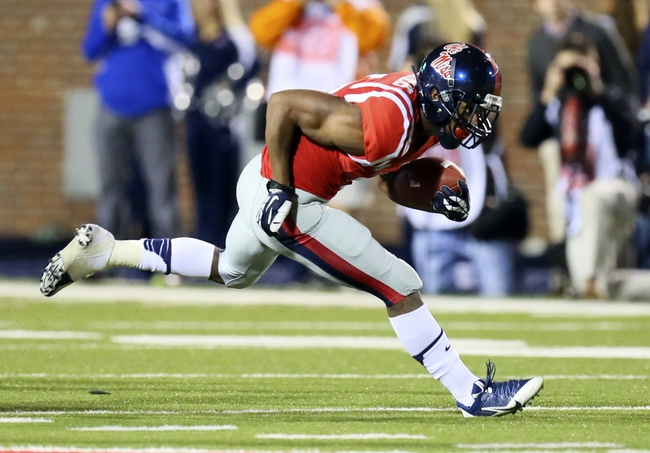 Oct 19, 2013; Oxford, MS, USA; Mississippi Rebels running back I'Tavius Mathers (5) advances the ball during the game against the LSU Tigers at Vaught-Hemingway Stadium. Mississippi Rebels defeat the LSU Tigers 27-24.  Mandatory Credit: Spruce Derden-USA TODAY Sports