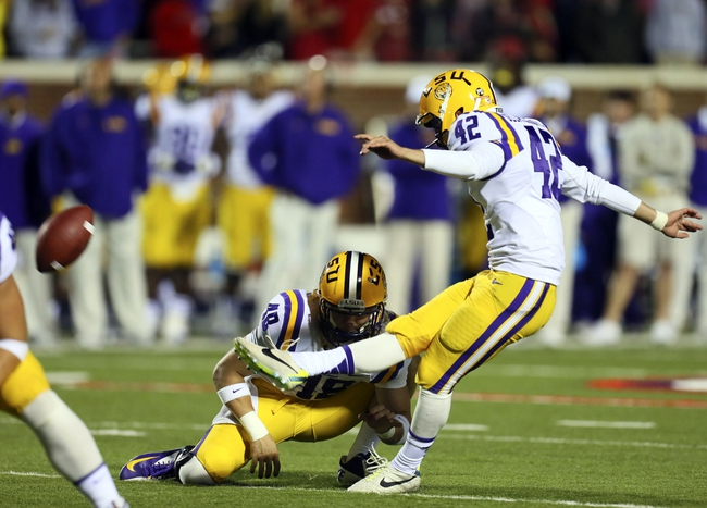 Oct 19, 2013; Oxford, MS, USA; LSU Tigers kicker Colby Delahoussaye (42) kicks a field goal during the game against the Mississippi Rebels at Vaught-Hemingway Stadium. Mississippi Rebels defeat the LSU Tigers 27-24.  Mandatory Credit: Spruce Derden-USA TODAY Sports