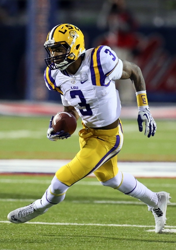 Oct 19, 2013; Oxford, MS, USA; LSU Tigers wide receiver Odell Beckham (3) advances the ball during the game against the Mississippi Rebels at Vaught-Hemingway Stadium. Mississippi Rebels defeat the LSU Tigers 27-24.  Mandatory Credit: Spruce Derden-USA TODAY Sports
