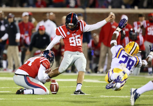 Oct 19, 2013; Oxford, MS, USA; Mississippi Rebels kicker Andrew Ritter (96) kicks a field goal in the final seconds during the game against the LSU Tigers at Vaught-Hemingway Stadium. Mississippi Rebels defeat the LSU Tigers 27-24.  Mandatory Credit: Spruce Derden-USA TODAY Sports