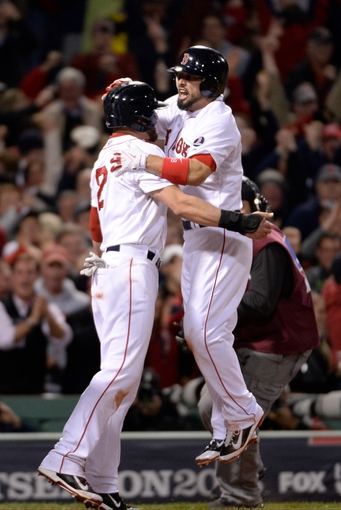 Oct 19, 2013; Boston, MA, USA; Boston Red Sox right fielder Shane Victorino (right) celebrates with center fielder Jacoby Ellsbury (2) after hitting a grand slam against the Detroit Tigers during the seventh inning in game six of the American League Championship Series playoff baseball game at Fenway Park. Mandatory Credit: Robert Deutsch-USA TODAY Sports