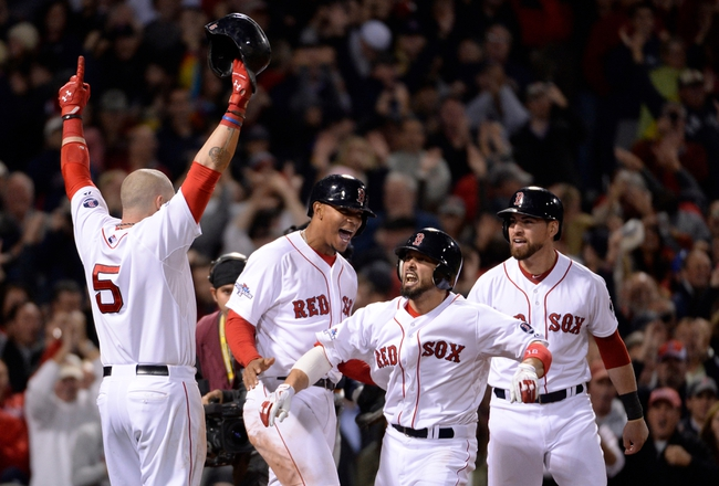 Oct 19, 2013; Boston, MA, USA; Boston Red Sox right fielder Shane Victorino (middle) celebrates with teammates including Jonny Gomes (5) after hitting a grand slam against the Detroit Tigers during the seventh inning in game six of the American League Championship Series playoff baseball game at Fenway Park. Mandatory Credit: Robert Deutsch-USA TODAY Sports