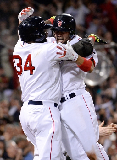 Oct 19, 2013; Boston, MA, USA; Boston Red Sox right fielder Shane Victorino (right) celebrates with designated hitter David Ortiz (34) after hitting a grand slam against the Detroit Tigers during the seventh inning in game six of the American League Championship Series playoff baseball game at Fenway Park. Mandatory Credit: Robert Deutsch-USA TODAY Sports