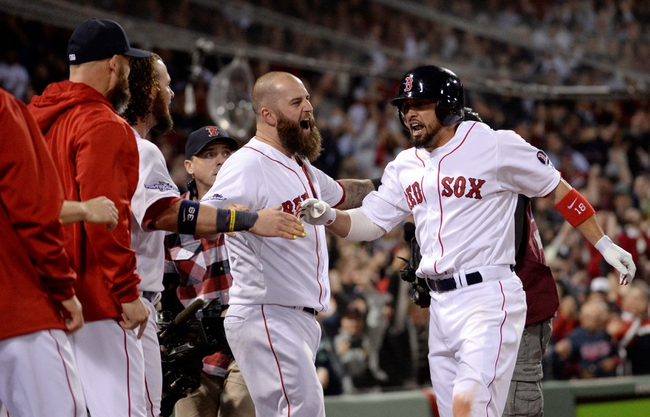 Oct 19, 2013; Boston, MA, USA; Boston Red Sox right fielder Shane Victorino (right) celebrates with teammates in the dugout after hitting a grand slam against the Detroit Tigers during the seventh inning in game six of the American League Championship Series playoff baseball game at Fenway Park. Mandatory Credit: Robert Deutsch-USA TODAY Sports