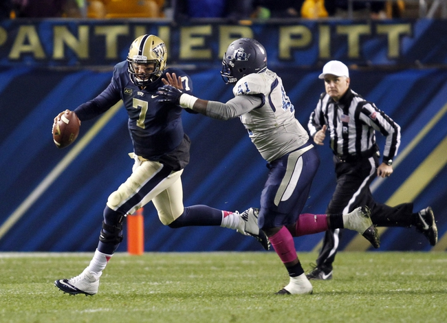 Oct 19, 2013; Pittsburgh, PA, USA; Pittsburgh Panthers quarterback Tom Savage (7) runs the ball under pressure from Old Dominion Monarchs linebacker Richie Staton (41) during the fourth quarter at Heinz Field.  Pittsburgh won 35-24. Mandatory Credit: Charles LeClaire-USA TODAY Sports