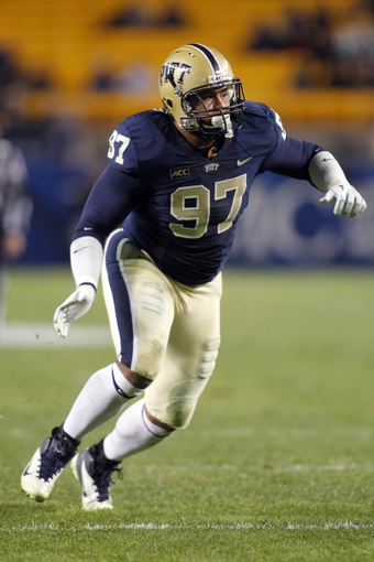 Oct 19, 2013; Pittsburgh, PA, USA; Pittsburgh Panthers defensive lineman Aaron Donald (97) rushes at the line of scrimmage against the Old Dominion Monarchs during the fourth quarter at Heinz Field.  Pittsburgh won 35-24. Mandatory Credit: Charles LeClaire-USA TODAY Sports