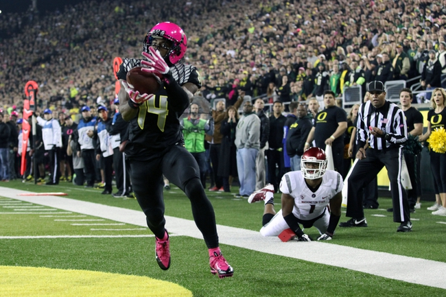 Oct 19, 2013; Eugene, OR, USA; Oregon Ducks cornerback Ifo Ekpre-Olomu (14) catches the ball for a touch back against the Washington State Cougars at Autzen Stadium. Mandatory Credit: Scott Olmos-USA TODAY Sports