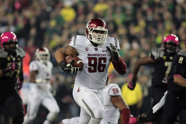 Oct 19, 2013; Eugene, OR, USA; Washington State Cougars defensive lineman Emmitt Su'a-Kalio picks up a fumble and runs the ball for a touchdown against the Oregon Ducks  at Autzen Stadium. Mandatory Credit: Scott Olmos-USA TODAY Sports