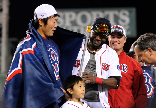 Oct 19, 2013; Boston, MA, USA; Boston Red Sox relief pitcher Koji Uehara (left) , designated hitter David Ortiz (middle) and manager John Farrell (right) celebrate after defeating the Detroit Tigers in game six of the American League Championship Series playoff baseball game at Fenway Park. Mandatory Credit: Robert Deutsch-USA TODAY Sports