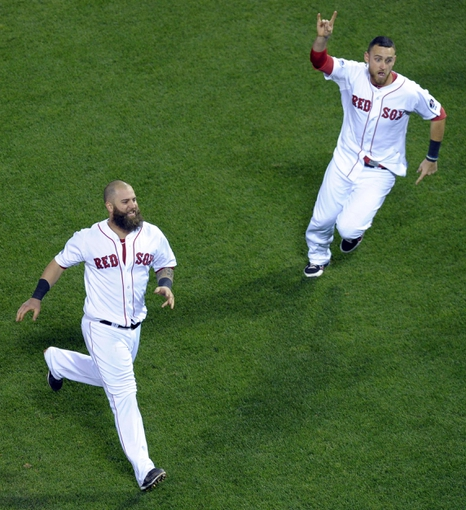 Oct 19, 2013; Boston, MA, USA; Boston Red Sox first baseman Mike Napoli (left) and third baseman Will Middlebrooks (right)  react after defeating the Detroit Tigers in game six of the American League Championship Series baseball game at Fenway Park. Mandatory Credit: Bob DeChiara-USA TODAY Sports