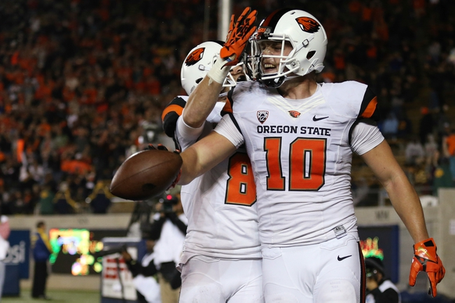 Oct 19, 2013; Berkeley, CA, USA; Oregon State Beavers tight end Caleb Smith (10) celebrates with wide receiver Richard Mullaney (8) after scoring touchdown against the California Golden Bears during the first quarter at Memorial Stadium. Mandatory Credit: Kelley L Cox-USA TODAY Sports