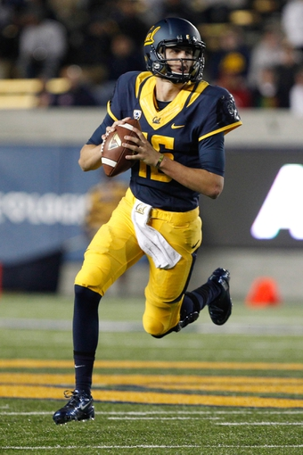 Oct 19, 2013; Berkeley, CA, USA; California Golden Bears quarterback Jared Goff (16) runs with the ball against the Oregon State Beavers during the second quarter at Memorial Stadium. Mandatory Credit: Kelley L Cox-USA TODAY Sports