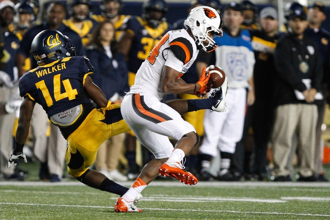 Oct 19, 2013; Berkeley, CA, USA; Oregon State Beavers wide receiver Kevin Cummings (84) misses a pass as California Golden Bears cornerback Cameron Walker (14) defends during the second quarter at Memorial Stadium. Mandatory Credit: Kelley L Cox-USA TODAY Sports