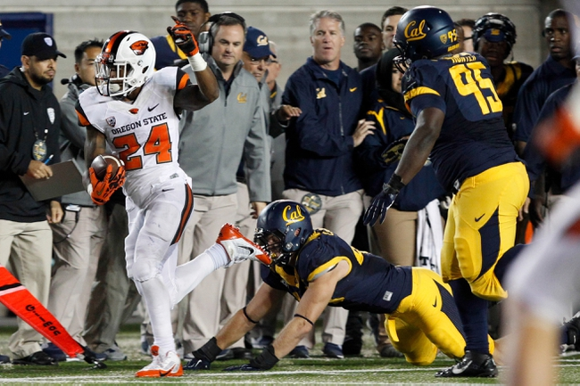Oct 19, 2013; Berkeley, CA, USA; Oregon State Beavers running back Storm Woods (24) runs with the ball against the California Golden Bears during the second quarter at Memorial Stadium. Mandatory Credit: Kelley L Cox-USA TODAY Sports