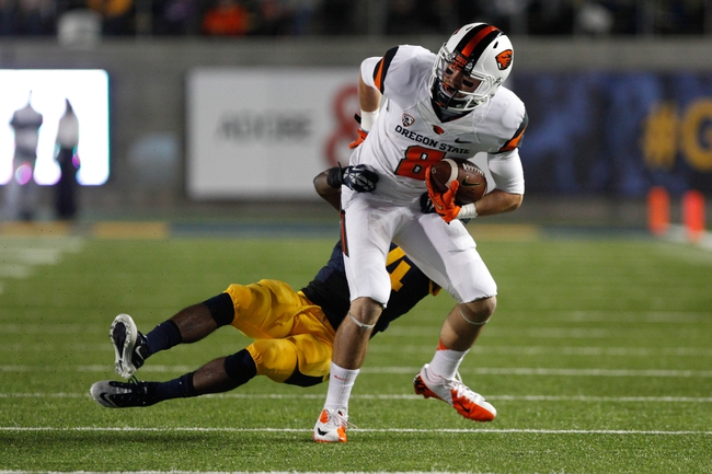Oct 19, 2013; Berkeley, CA, USA; California Golden Bears cornerback Cameron Walker (14) tackles Oregon State Beavers wide receiver Richard Mullaney (8) during the second quarter at Memorial Stadium. Mandatory Credit: Kelley L Cox-USA TODAY Sports
