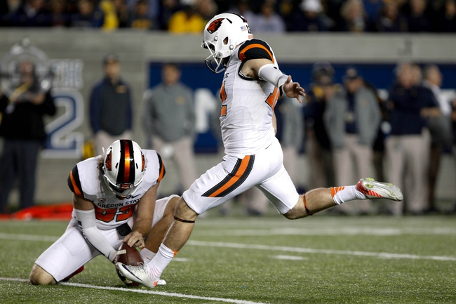 Oct 19, 2013; Berkeley, CA, USA; Oregon State Beavers kicker Trevor Romaine (12) kicks a field goal against the California Golden Bears during the second quarter at Memorial Stadium. Mandatory Credit: Kelley L Cox-USA TODAY Sports