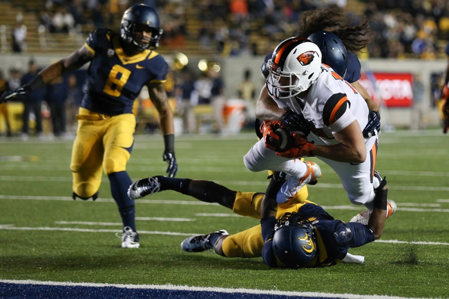 Oct 19, 2013; Berkeley, CA, USA; California Golden Bears defensive back Joel Willis (18) and defensive end Puka Lopa (75) tackle Oregon State Beavers tight end Caleb Smith (10) during the second quarter at Memorial Stadium. Mandatory Credit: Kelley L Cox-USA TODAY Sports