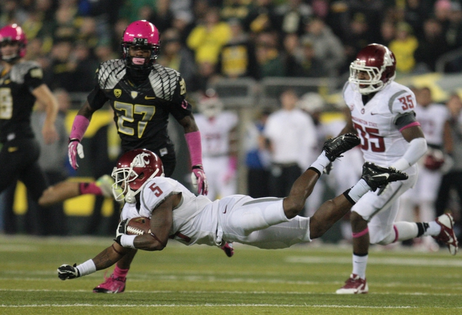Oct 19, 2013; Eugene, OR, USA; Washington State Cougars wide receiver Rickey Galvin (5) falls as he returns a kick against the Oregon Ducks at Autzen Stadium. Mandatory Credit: Scott Olmos-USA TODAY Sports