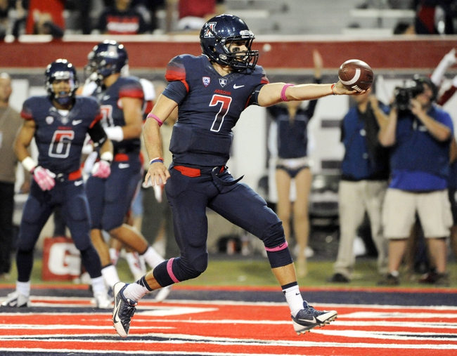 Oct 19, 2013; Tucson, AZ, USA; Arizona Wildcats quarterback B.J. Denker (7) gets a two point conversion during the fourth quarter against the Utah Utes at Arizona Stadium. Arizona beat Utah 35-44. Mandatory Credit: Casey Sapio-USA TODAY Sports