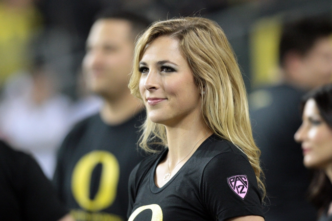 Oct 19, 2013; Eugene, OR, USA; Oregon Ducks cheerleader entertains the fans against the Washington State Cougars at Autzen Stadium. Mandatory Credit: Scott Olmos-USA TODAY Sports