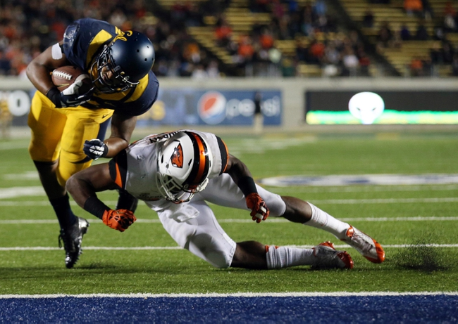 Oct 19, 2013; Berkeley, CA, USA; California Golden Bears running back Darren Ervin (34) scores a touchdown against Oregon State Beavers safety Ryan Murphy (25) during the third quarter at Memorial Stadium. The Oregon State Beavers defeated the California Golden Bears 49-17. Mandatory Credit: Kelley L Cox-USA TODAY Sports