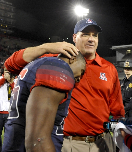 Oct 19, 2013; Tucson, AZ, USA; Arizona Wildcats head coach Rich Rodriguez and running back KaDeem Carey (25) celebrate the victory against the Utah Utes at Arizona Stadium. Arizona beat Utah 35-44. Mandatory Credit: Casey Sapio-USA TODAY Sports