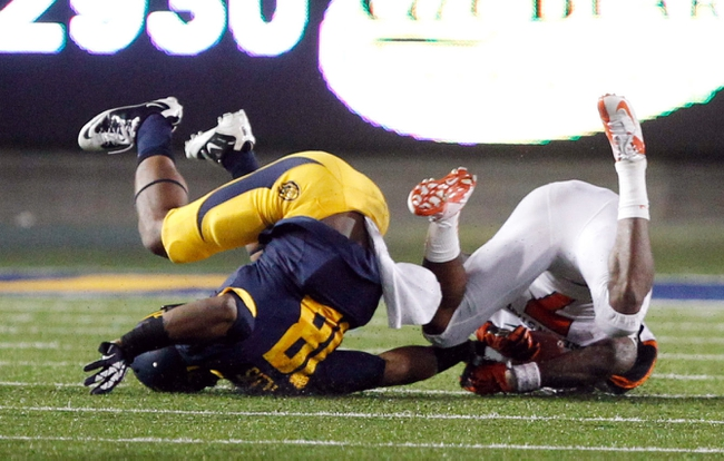 Oct 19, 2013; Berkeley, CA, USA; California Golden Bears defensive back Joel Willis (18) breaks up the pass intended for Oregon State Beavers wide receiver Brandin Cooks (7) during the fourth quarter at Memorial Stadium. The Oregon State Beavers defeated the California Golden Bears 49-17. Mandatory Credit: Kelley L Cox-USA TODAY Sports