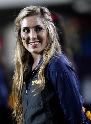 Oct 19, 2013; Berkeley, CA, USA; California Golden Bears cheerleader during the fourth quarter against the Oregon State Beavers at Memorial Stadium. The Oregon State Beavers defeated the California Golden Bears 49-17. Mandatory Credit: Kelley L Cox-USA TODAY Sports