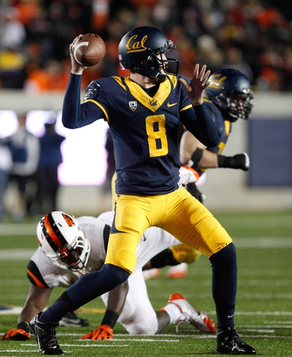 Oct 19, 2013; Berkeley, CA, USA; California Golden Bears quarterback Zach Kline (8) passes the ball against the Oregon State Beavers during the fourth quarter at Memorial Stadium. The Oregon State Beavers defeated the California Golden Bears 49-17. Mandatory Credit: Kelley L Cox-USA TODAY Sports