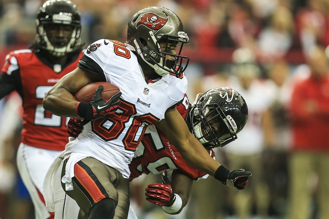 Oct 20, 2013; Atlanta, GA, USA; Tampa Bay Buccaneers wide receiver Chris Owusu (80) is tackled after a catch by Atlanta Falcons linebacker Joplo Bartu (59) in the first half at the Georgia Dome. Mandatory Credit: Daniel Shirey-USA TODAY Sports