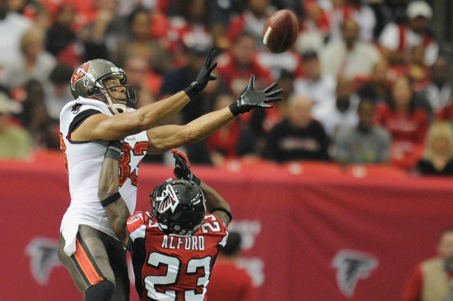 Oct 20, 2013; Atlanta, GA, USA; Tampa Bay Buccaneers wide receiver Vincent Jackson (83) catches a pass over top of Atlanta Falcons cornerback Robert Alford (23) during the second quarter at the Georgia Dome. Mandatory Credit: Dale Zanine-USA TODAY Sports