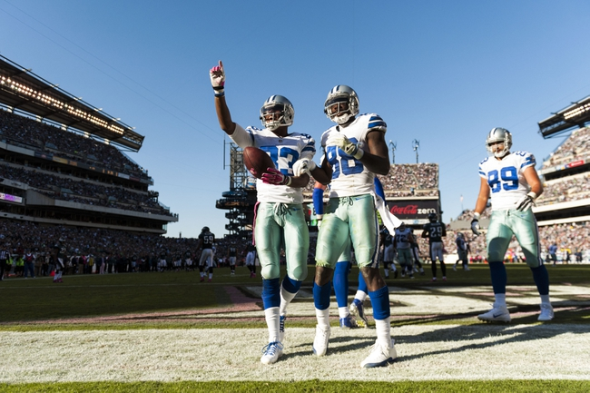 Oct 20, 2013; Philadelphia, PA, USA; Dallas Cowboys wide receiver Terrance Williams (83) celebrates scoring a touchdown with wide receiver Dez Bryant (88) during the fourth quarter against the Philadelphia Eagles at Lincoln Financial Field. Mandatory Credit: Howard Smith-USA TODAY Sports