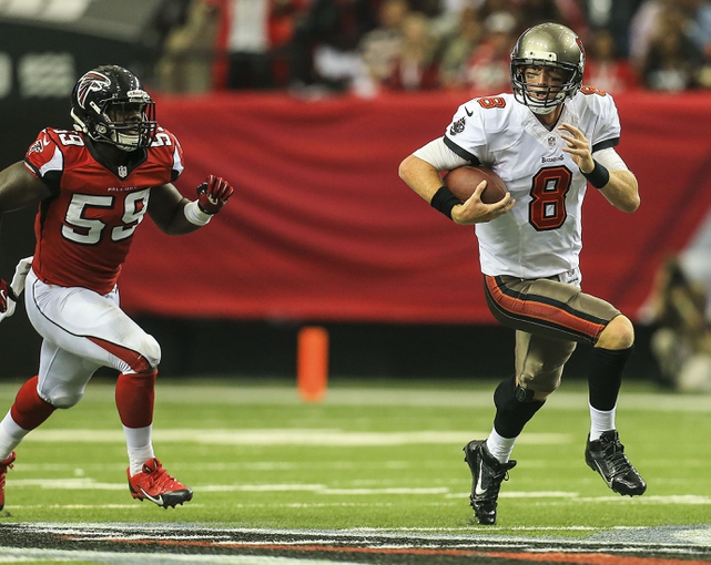 Oct 20, 2013; Atlanta, GA, USA; Tampa Bay Buccaneers quarterback Mike Glennon (8) runs the ball in the second half against the Atlanta Falcons at the Georgia Dome. The Falcons won 31-23. Mandatory Credit: Daniel Shirey-USA TODAY Sports