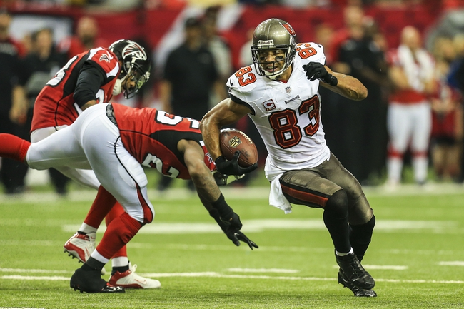Oct 20, 2013; Atlanta, GA, USA; Tampa Bay Buccaneers wide receiver Vincent Jackson (83) runs after a catch in the second half against the Atlanta Falcons at the Georgia Dome. The Falcons won 31-23. Mandatory Credit: Daniel Shirey-USA TODAY Sports