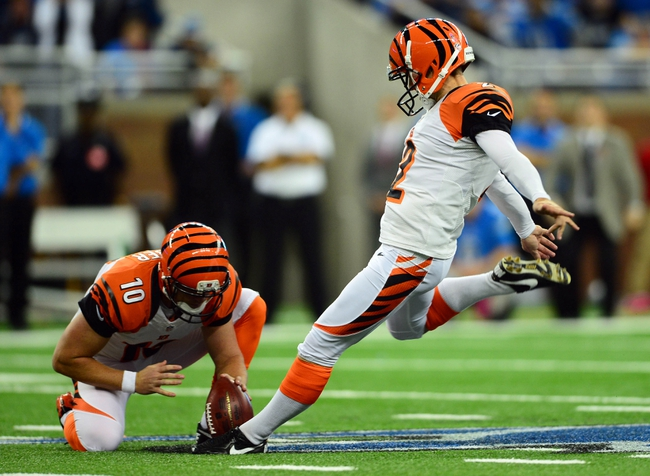 Oct 20, 2013; Detroit, MI, USA; Cincinnati Bengals kicker Mike Nugent (2) kicks the game winning field goal to defeat the Detroit Lions 27-24 at Ford Field. Mandatory Credit: Andrew Weber-USA TODAY Sports
