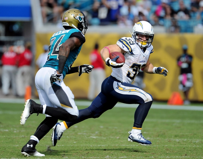 Oct 20, 2013; Jacksonville, FL, USA; San Diego Chargers running back Danny Woodhead (39) runs the ball past Jacksonville Jaguars cornerback Will Blackmon (24) during the second half at EverBank Field. Mandatory Credit: Melina Vastola-USA TODAY Sports